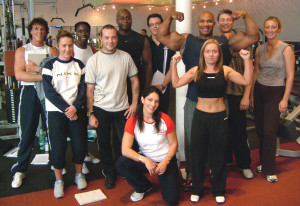 A happy group of students on a GB Fitness Personal Trainer qualification course - including Jet from TV's Gladiators and professional body builder Len St Cyr.